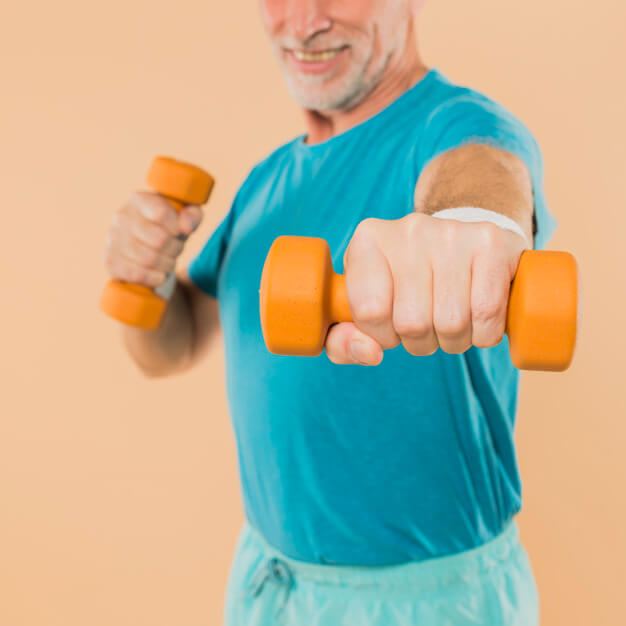 modern-senior-man-training-with-dumbbells_23-2148001325